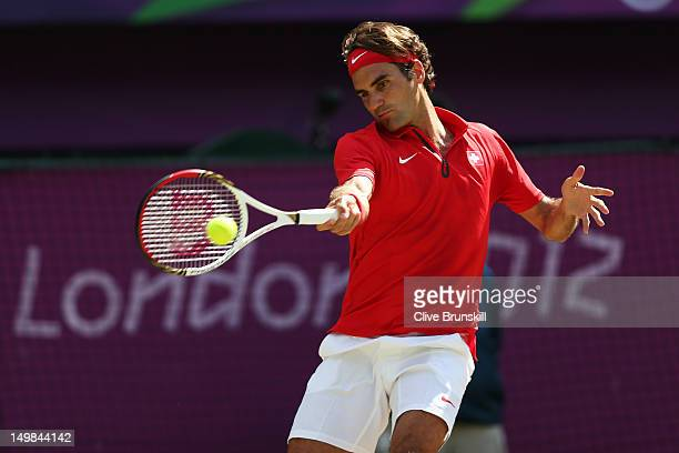 Roger Federer of Switzerland returns a shot against Andy Murray of Great Britain during the Men's Singles Tennis Gold Medal Match on Day 9 of the...