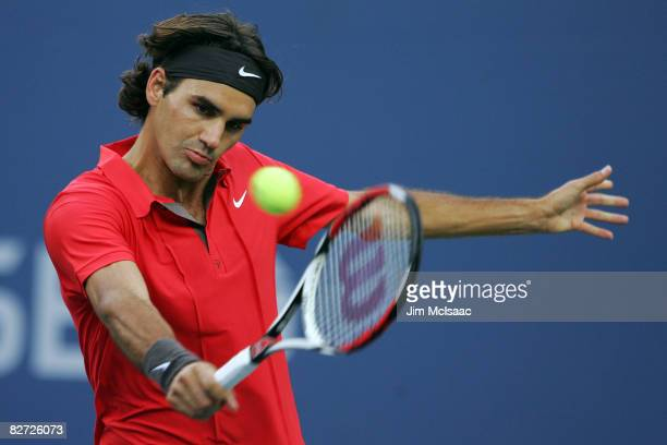 Roger Federer of Switzerland returns a shot against Andy Murray of the United Kingdom in the 2008 US Open Men's Championship Match in Arthur Ashe...