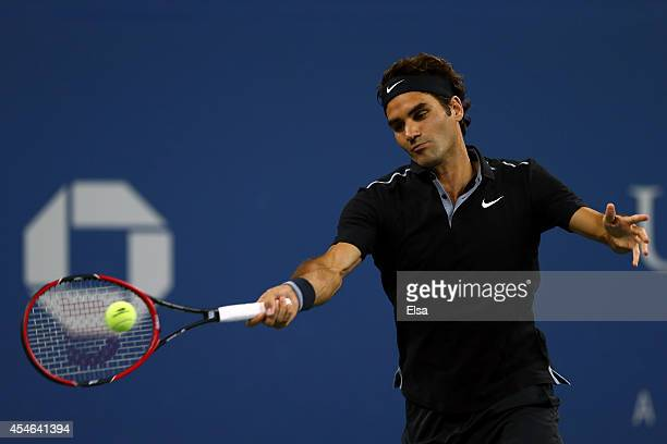 Roger Federer of Switzerland returns a shot against Gael Monfils of France during their men's singles quarterfinal match on Day Eleven of the 2014 US...