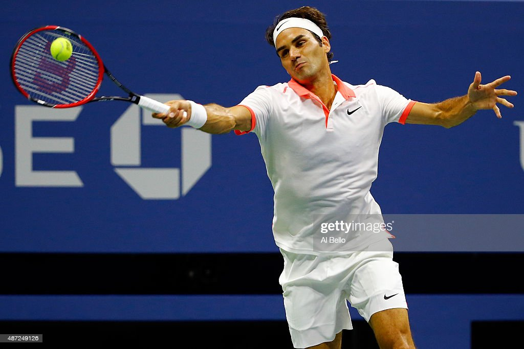 Roger Federer of Switzerland returns a shot against John Isner of the United States during their Men's Singles Fourth Round match on Day Eight of the 2015 US Open at the USTA Billie Jean King National Tennis Center on September 7, 2015 in the Flushing neighborhood of the Queens borough of New York City.