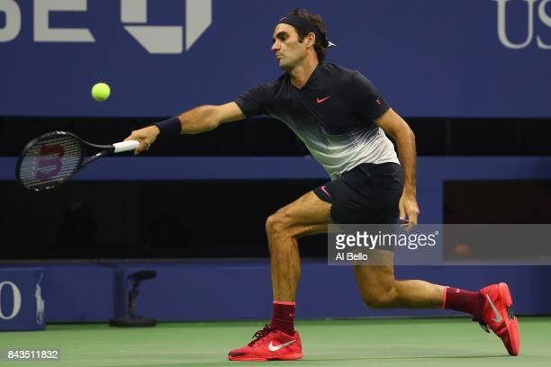 Roger Federer of Switzerland returns a shot against Juan Martin del Potro of Argentina during their Men's Singles Quarterfinal match on Day Ten of...