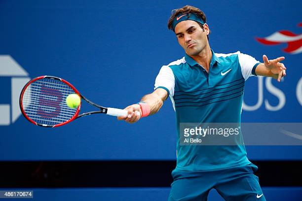 Roger Federer of Switzerland returns a shot against Leonardo Mayer of Argentina during their Men's Singles First Round match on Day Two of the 2015...