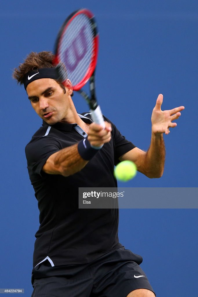 Roger Federer of Switzerland returns a shot against Marinko Matosevic of Australia during their men's singles first round match on Day Two of the 2014 US Open at the USTA Billie Jean King National Tennis Center on August 26, 2014 in the Flushing neighborhood of the Queens borough of New York City.