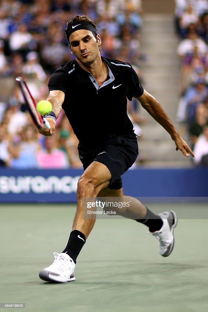 Roger Federer of Switzerland returns a shot against Roberto Bautista Agut of Spain during their men's singles fourth round match on Day Nine of the 2014 US Open at the USTA Billie Jean King National Tennis Center on September 2, 2014 in the Flushing neighborhood of the Queens borough of New York City.