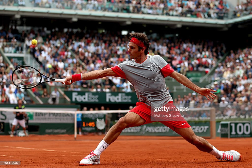 <a gi-track='captionPersonalityLinkClicked' href=/galleries/search?phrase=Roger+Federer&family=editorial&specificpeople=157480 ng-click='$event.stopPropagation()'>Roger Federer</a> of Switzerland returns a shot during his men's singles match against Ernests Gulbis of Latvia on day eight of the French Open at Roland Garros on June 1, 2014 in Paris, France.