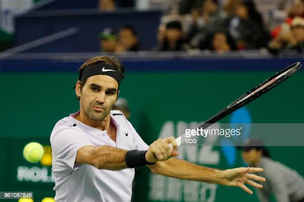 Roger Federer of Switzerland returns a shot during the Men's singles quarterfinal mach against Richard Gasquet of France on day six of 2017 ATP...