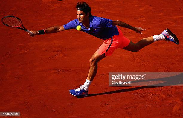 Roger Federer of Switzerland returns a shot in his Men's quarter final match against Stanislas Wawrinka of Switzerland on day of the 2015 French Open...