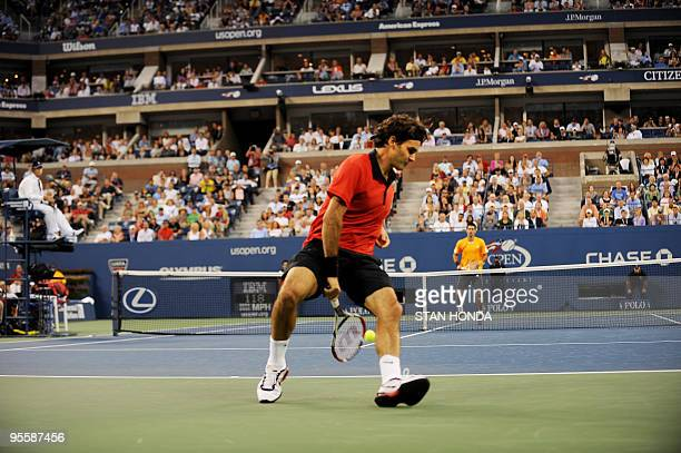 Roger Federer of Switzerland returns a shot through his legs to Novak Djokovic of Serbia during their semifinal match at the 2009 US Open at the USTA...