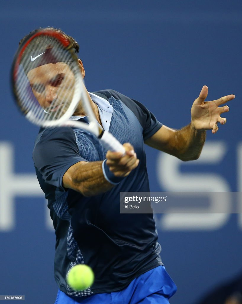 <a gi-track='captionPersonalityLinkClicked' href=/galleries/search?phrase=Roger+Federer&family=editorial&specificpeople=157480 ng-click='$event.stopPropagation()'>Roger Federer</a> of Switzerland returns a shot to Adrian Mannarino of France in the first set during the round match on Day Six of the 2013 US Open at USTA Billie Jean King National Tennis Center on August 31, 2013 in the Flushing neighborhood of the Queens borough of New York City.