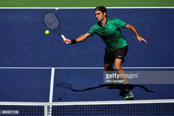 Roger Federer of Switzerland returns a shot to Jack Sock of the United States in the men's semifinal on day 13 during the BNP Paribas Open at Indian...