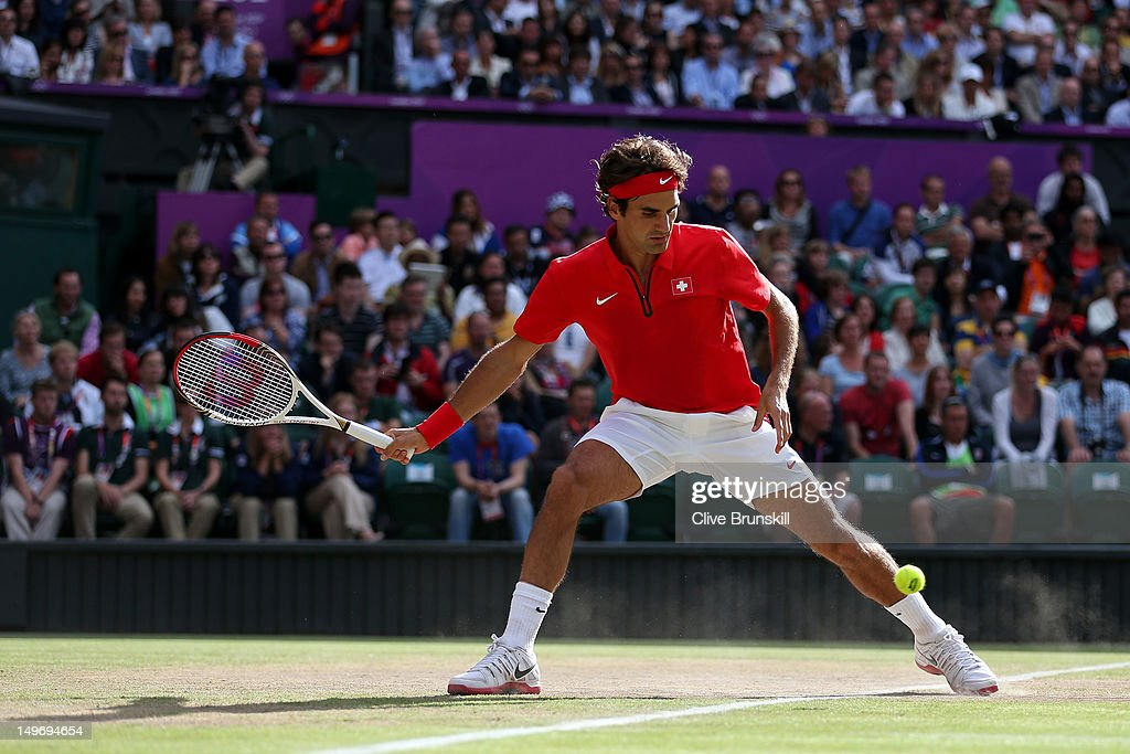 <a gi-track='captionPersonalityLinkClicked' href=/galleries/search?phrase=Roger+Federer&family=editorial&specificpeople=157480 ng-click='$event.stopPropagation()'>Roger Federer</a> of Switzerland returns a shot to John Isner of the United States during the Quarterfinal of Men's Singles Tennis on Day 6 of the London 2012 Olympic Games at Wimbledon on August 2, 2012 in London, England.