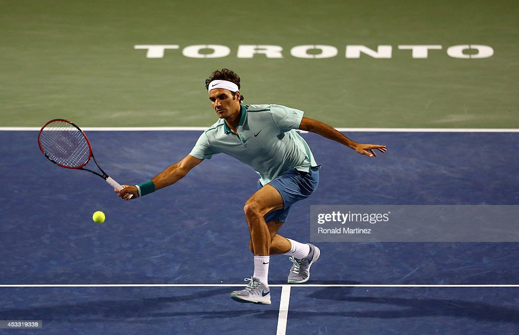 Roger Federer of Switzerland returns a shot to Marin Cilic of Croatia during Rogers Cup at Rexall Centre at York University on August 7, 2014 in Toronto, Canada.