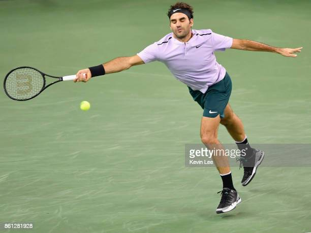 Roger Federer of Switzerland returns a shot to Marin Cilic of Croatia on Day 7 of 2017 ATP 1000 Shanghai Rolex Masters during Men's Single SemiFinal...