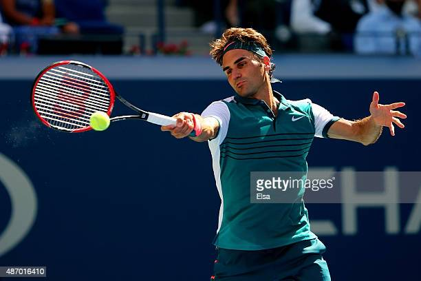 Roger Federer of Switzerland returns a shot to Philipp Kohlschreiber of Germany during their Men's Singles Third Round match on Day Six of the 2015...