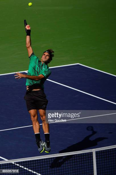 Roger Federer of Switzerland returns a shot to Stan Wawrinka of Switzerland in the men's final on day 14 during the BNP Paribas Open at Indian Wells...