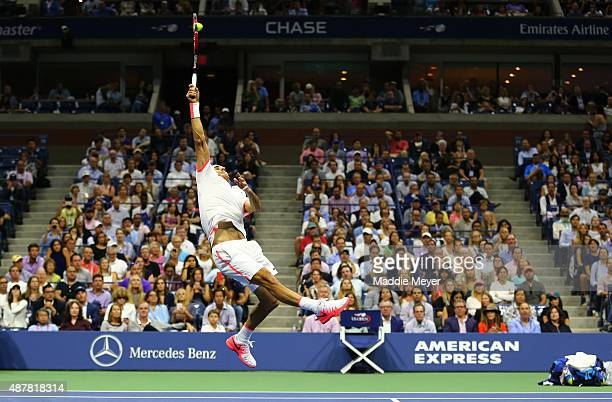 Roger Federer of Switzerland returns a shot to Stan Wawrinka of Switzerland during their Men's Singles Semifinals match on Day Twelve of the 2015 US...
