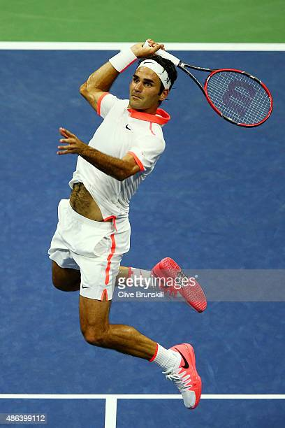 Roger Federer of Switzerland returns a shot to Steve Darcis of Belgium during their Men's Singles Second Round match on Day Four of the 2015 US Open...