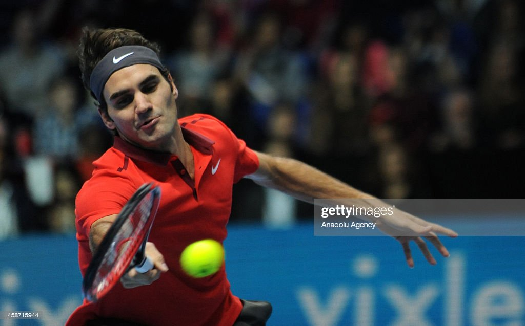 Roger Federer of Switzerland returns the ball during his match against Milos Raonic of Canada on day one of the Barclays ATP World Tour Finals tennis at O2 Arena on November 9, 2014 in London, England.
