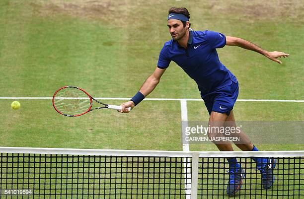 Roger Federer of Switzerland returns the ball to Alexander Zverev of Germany during the ATP tour tennis match in Halle western Germany on June 18...