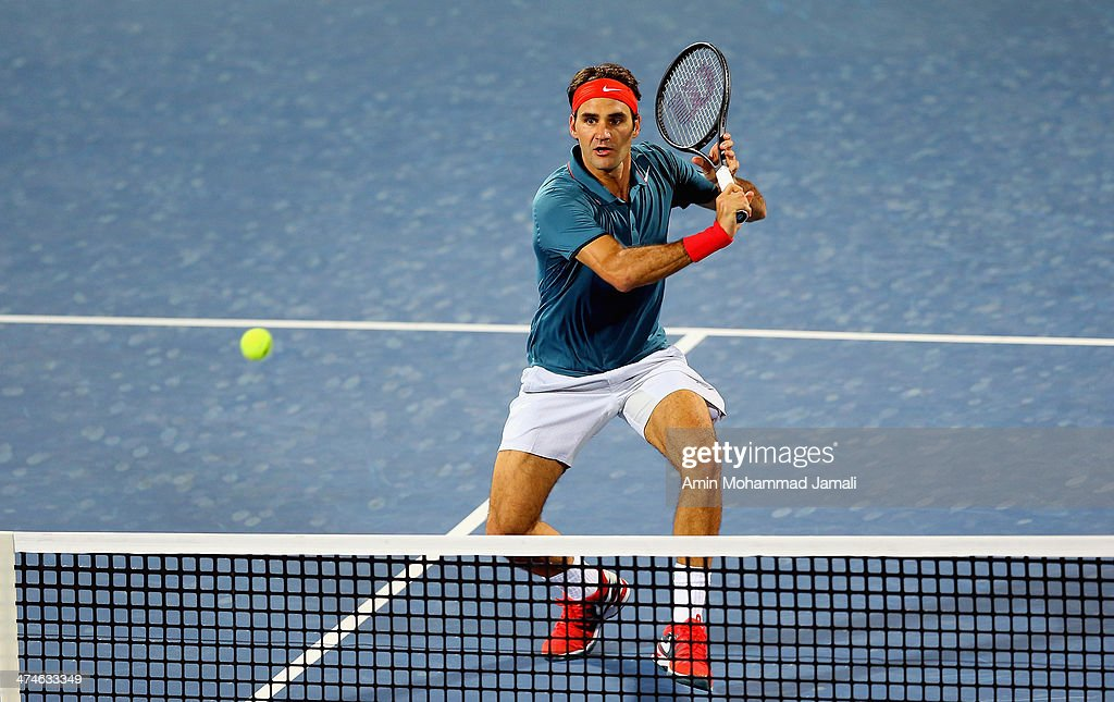 <a gi-track='captionPersonalityLinkClicked' href=/galleries/search?phrase=Roger+Federer&family=editorial&specificpeople=157480 ng-click='$event.stopPropagation()'>Roger Federer</a> of Switzerland returns the ball to Benjamin Becker of Germany during their first round match of the Dubai Duty Free Tennis ATP Championships in Dubai on February 24, 2014 in Dubai, United Arab Emirates.