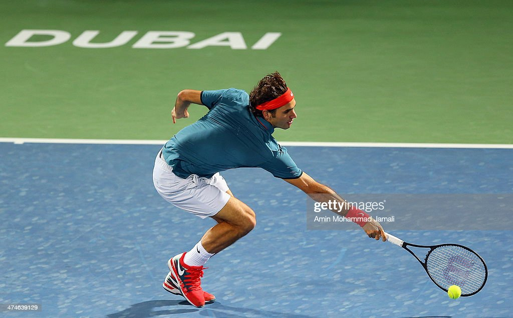 Roger Federer of Switzerland returns the ball to Benjamin Becker of Germany during their first round match of the Dubai Duty Free Tennis ATP Championships in Dubai on February 24, 2014 in Dubai, United Arab Emirates.