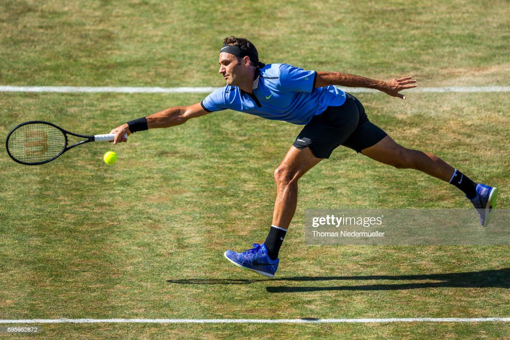 Roger Federer of Switzerland returns the Ball to Tommy Haas of Germany during their round of sixteen match of Mercedes Cup 2017 on June 14, 2017 in Stuttgart, Germany.