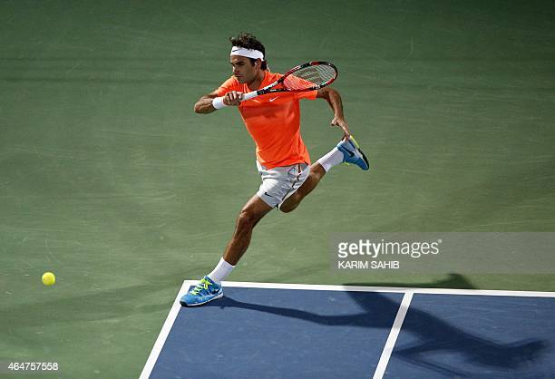 Roger Federer of Switzerland returns the ball to World number one Novak Djokovic of Serbia during their final match on the fifth day of the ATP Dubai...