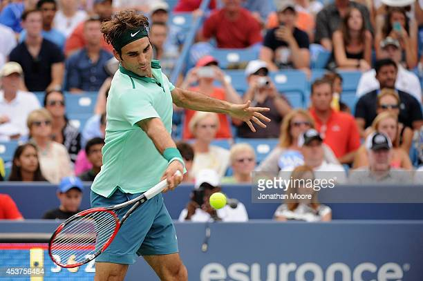 Roger Federer of Switzerland returns to David Ferrer of Spain during a final match on day 9 of the Western Southern Open at the Linder Family Tennis...