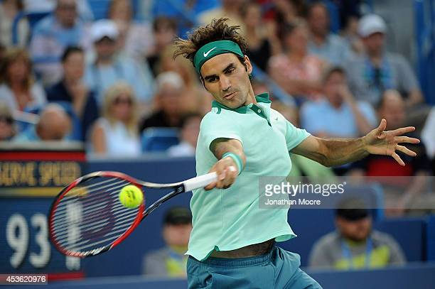 Roger Federer of Switzerland returns to Gael Monfils of France during a match on day 6 of the Western Southern Open at the Linder Family Tennis...