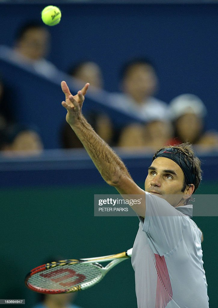 Roger Federer of Switzerland serves against Andreas Seppi of Italy during their men's singles match in the Shanghai Masters tennis tournament in Shanghai on October 9, 2013. AFP PHOTO/Peter PARKS