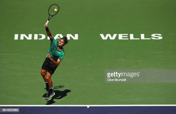 Roger Federer of Switzerland serves against Jack Sock of the United States in their semi final match during day thirteen of the BNP Paribas Open at...