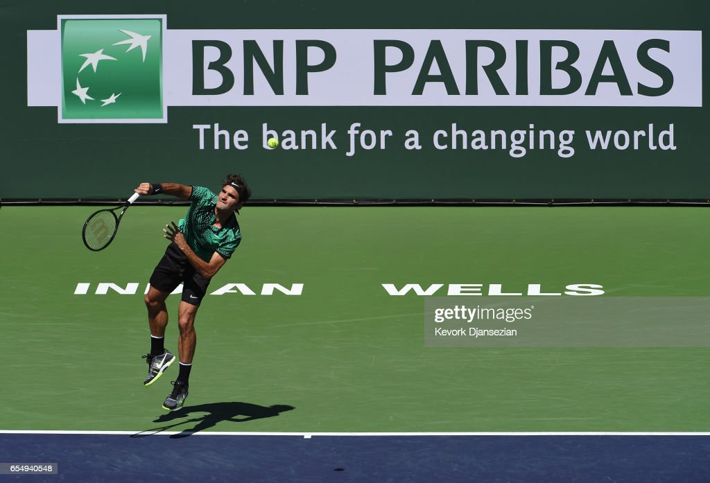Roger Federer of Switzerland serves against Jack Sock of the United States in their semi final match during day thirteen of the BNP Paribas Open at Indian Wells Tennis Garden on March 18, 2017 in Indian Wells, California.