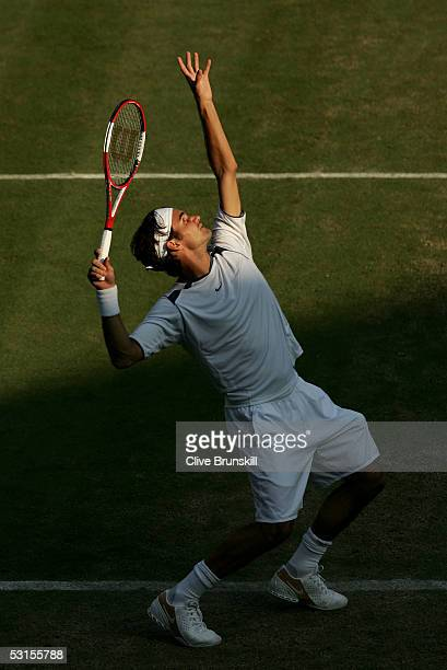 Roger Federer of Switzerland serves against Juan Carlos Ferrero of Spain during the seventh day of the Wimbledon Lawn Tennis Championship on June 27...