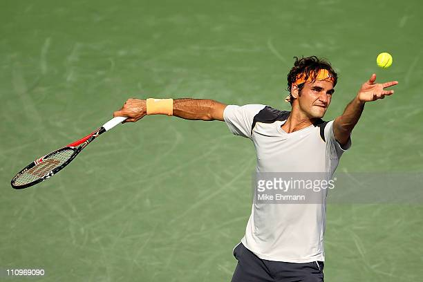 Roger Federer of Switzerland serves against Juan Monaco of Argentina during the Sony Ericsson Open at Crandon Park Tennis Center on March 28 2011 in...