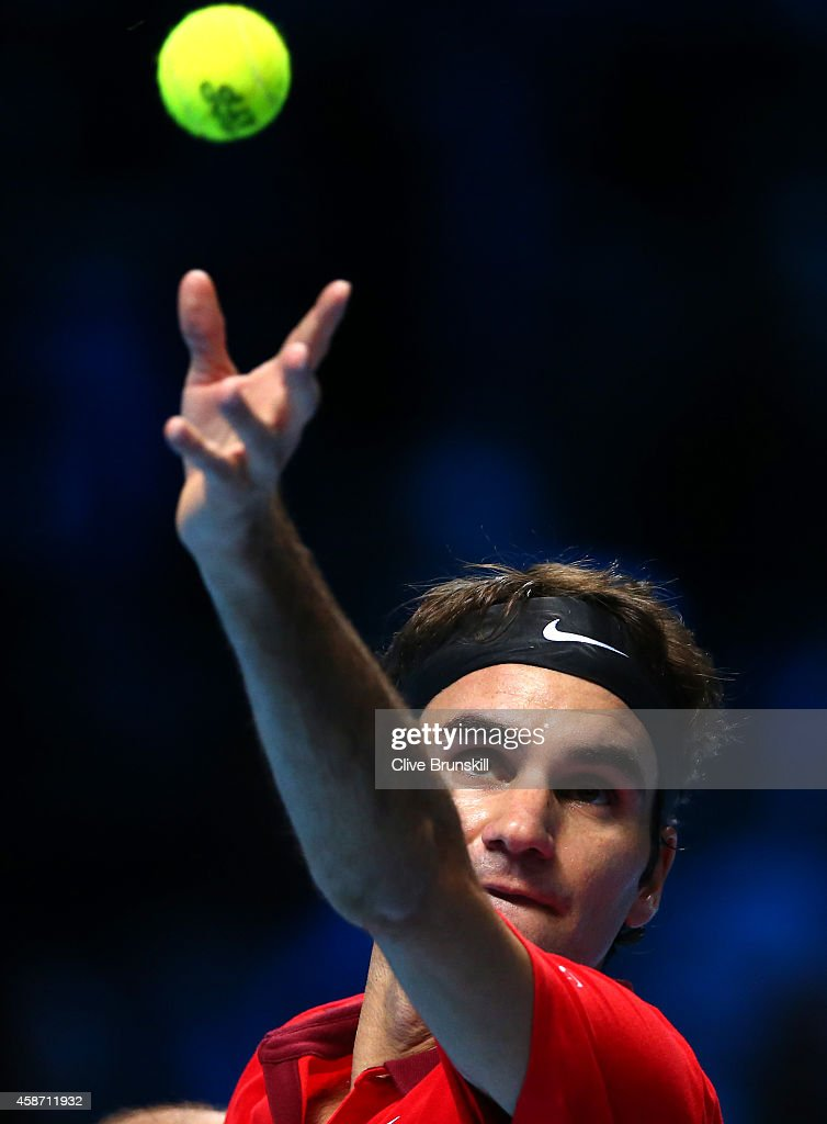 Roger Federer of Switzerland serves against Milos Raonic of Canada during their round robin match during the Barclays ATP World Tour Finals at the O2 Arena on November 9, 2014 in London, England.