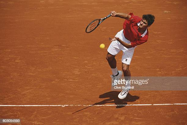 Roger Federer of Switzerland serves against Pat Rafter during their Men's Singles first round match at the French Open Tennis Championship on 25 May...