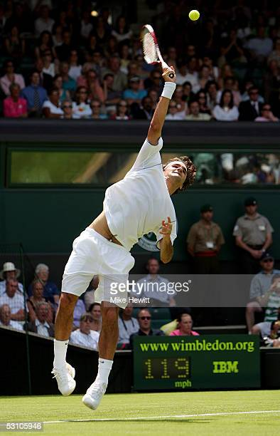 Roger Federer of Switzerland serves against PaulHenri Mathieu of France during the first round of the Wimbledon Lawn Tennis Championship on June 20...