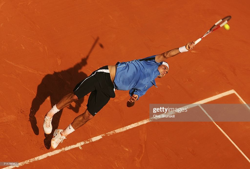 Roger Federer of Switzerland serves against Rafael Nadal of Spain during the Men?s Singles Final on day fifteen of the French Open at Roland Garros on June 11, 2006 in Paris, France.