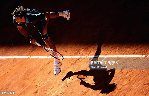Roger Federer of Switzerland serves against Rafael Nadal of Spain during the Madrid Open Men's Final at the Caja Magica on May 17 2009 in Madrid Spain