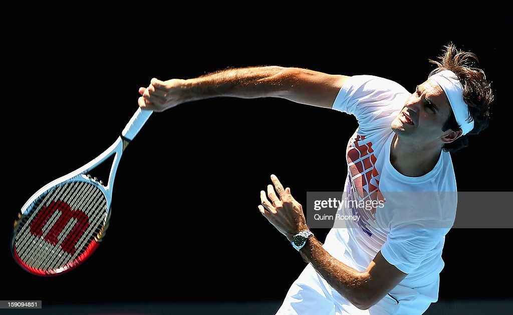 <a gi-track='captionPersonalityLinkClicked' href=/galleries/search?phrase=Roger+Federer&family=editorial&specificpeople=157480 ng-click='$event.stopPropagation()'>Roger Federer</a> of Switzerland serves during practice ahead of the 2013 Australian Open at Melbourne Park on January 8, 2013 in Melbourne, Australia.