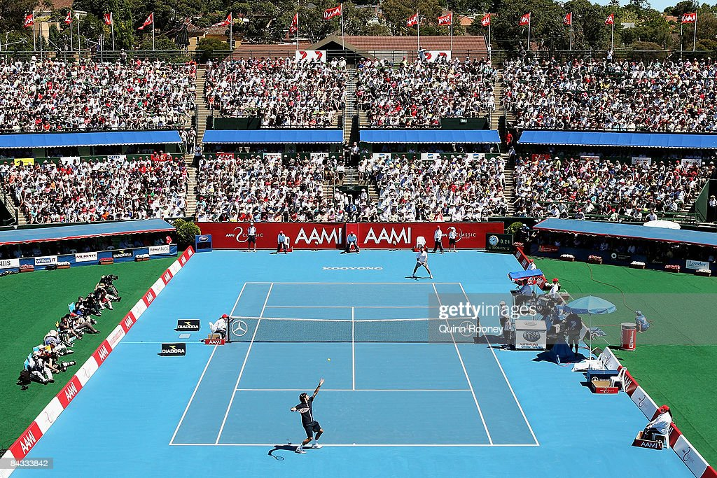 Roger Federer of Switzerland serves during the final against Stanislas Wawrinka of Switzerland on day four of the AAMI Classic at the Kooyong Lawn...