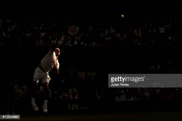 Roger Federer of Switzerland serves during the Gentlemen's Singles fourth round match against Grigor Dimitrov of Bulgaria on day seven of the...