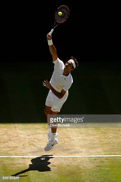 Roger Federer of Switzerland serves during the Men's Singles Quarter Finals match against Marin Cilic of Croatia on day nine of the Wimbledon Lawn...