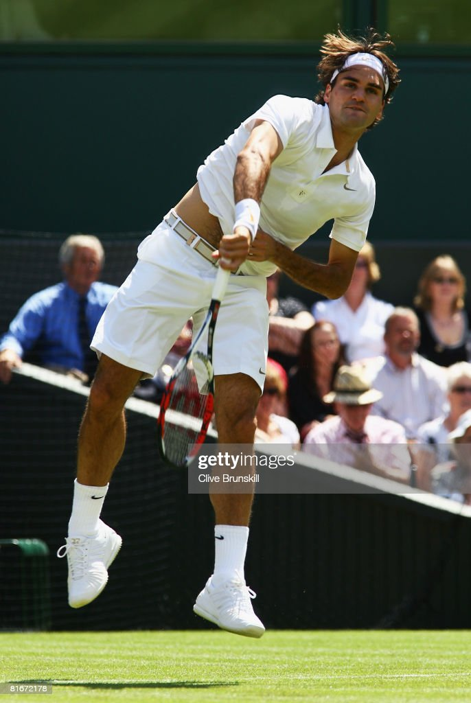 Roger Federer of Switzerland serves during the men's singles round one match against Dominik Hrbaty of Slovakia on day one of the Wimbledon Lawn...