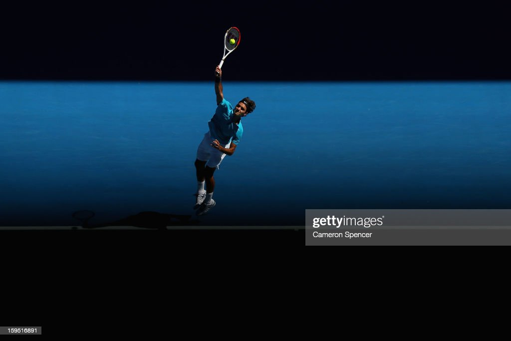 <a gi-track='captionPersonalityLinkClicked' href=/galleries/search?phrase=Roger+Federer&family=editorial&specificpeople=157480 ng-click='$event.stopPropagation()'>Roger Federer</a> of Switzerland serves in his first round match against Benoit Paire of France during day two of the 2013 Australian Open at Melbourne Park on January 15, 2013 in Melbourne, Australia.
