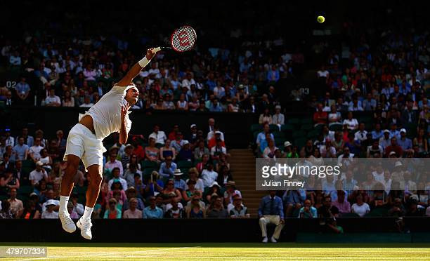 Roger Federer of Switzerland serves in his Gentlemen's Singles Fourth Round match against Roberto Bautista Agut of Spain during day seven of the...