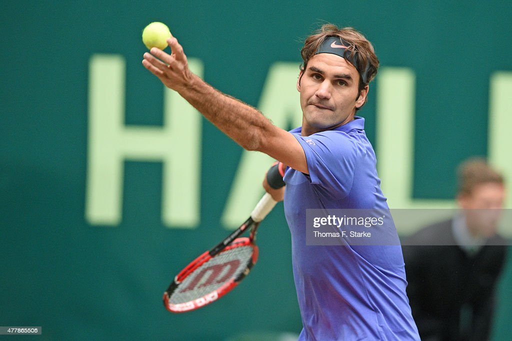Roger Federer of Switzerland serves in his match against Ivo Karlovic of Croatia during day six of the Gerry Weber Open at Gerry Weber Stadium on...