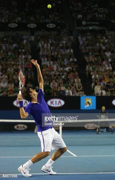 Roger Federer of Switzerland serves in his men's final match against Rafael Nadal of Spain during day fourteen of the 2009 Australian Open at...
