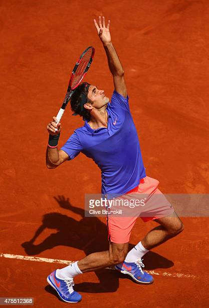Roger Federer of Switzerland serves in his Men's Singles match against Gael Monfils of France on day nine of the 2015 French Open at Roland Garros on...