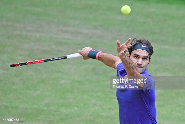 Roger Federer of Switzerland serves in the final match against Andreas Seppi of Italy during the final day of the Gerry Weber Open at Gerry Weber...